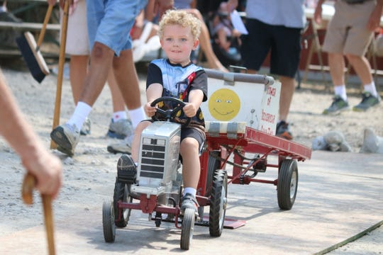 """Nolan Salisbury gives it his all on his way to a """"full pull"""" during the Kiddie Pedal Tractor Pull at the S.C.R.A.P. Show on Saturday."""