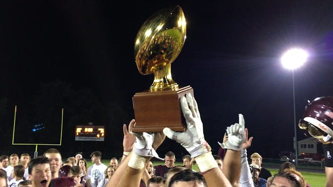Genoa retired a Celestial Bowl Trophy with its third straight victory Friday over Oak Harbor.
