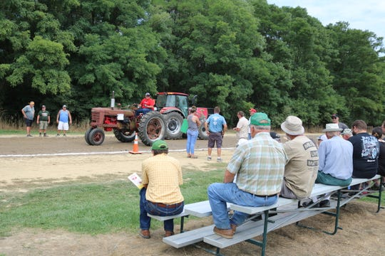 Fans watch an antique tractor pull at the 30th annual S.C.R.A.P. Show at White Star Park in Gibsonburg on Saturday.