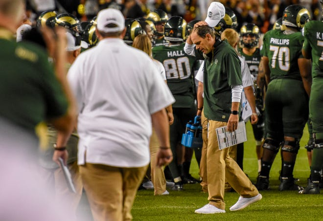 Colorado State head coach Mike Bobo scratches his head in frustration against Colorado during the Rocky Mountain Showdown at Broncos Stadium in Denver on Friday Aug. 31, 2018. (Cris Tiller / Fort Collins Coloradoan)