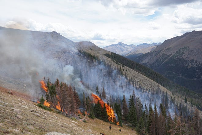 Air and ground crews worked to suppress the Forest Canyon Fire at Rocky Mountain National Park on Friday, Aug. 31, 2018.