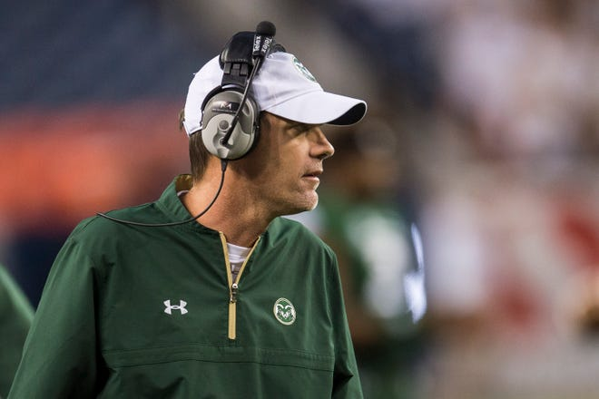 Colorado State University head coach Mike Bobo looks on from the sideline before the opening kickoff of the Rocky Mountain Showdown rivalry game against the University of Colorado on Friday, Aug. 31, 2018, at Broncos Stadium in Denver, Colo.