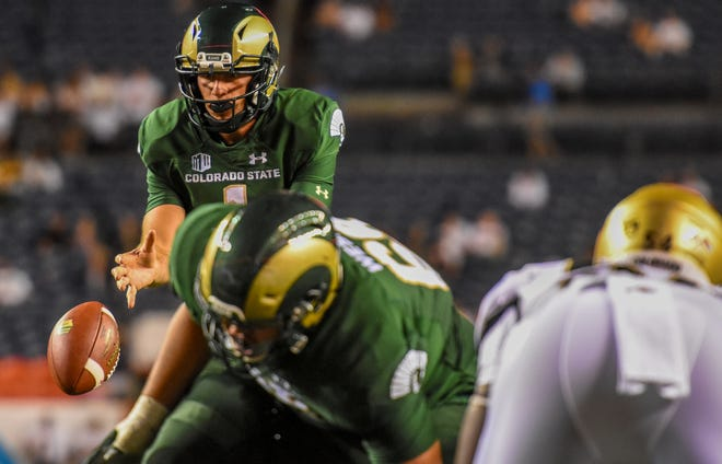 CSU quarterback K.J. Carta-Samuels, shown taking a snap during last weekend's loss in Denver to the University of Colorado, says he and his teammates are eager to see how they fare in their next two games against teams from the powerful Southeastern Conference.