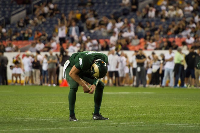 Colorado State University senior quarterback K.J. Carta-Samuels (1) reacts to an overthrown pass during a game against the University of Colorado on Friday, Aug. 31, 2018, at Broncos Stadium in Denver, Colo.