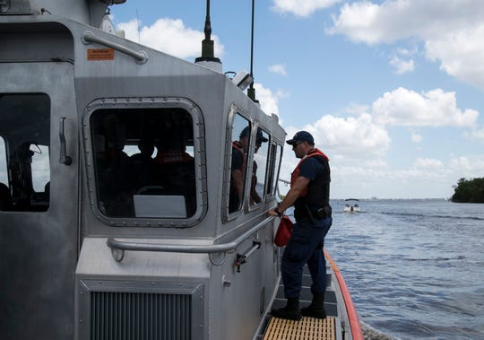 Coast Guard crew from the Fort Myers Beach Station patrols the mouth of the Caloosahatchee River. Blue-green algae has been present in the river for a few weeks now.