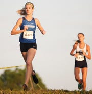 Canterbury School's Jessica Edwards competes on Saturday in the DDD Sommer Invitational at Estero Community Park. Edwards placed second. High Schools from throughout Southwest Florida competed in the annual race.