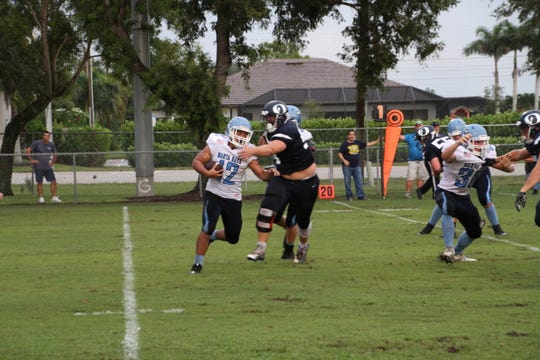 Oasis linebacker Hayden Knighton makes a tackle against Marco Island on Aug. 31, 2018.