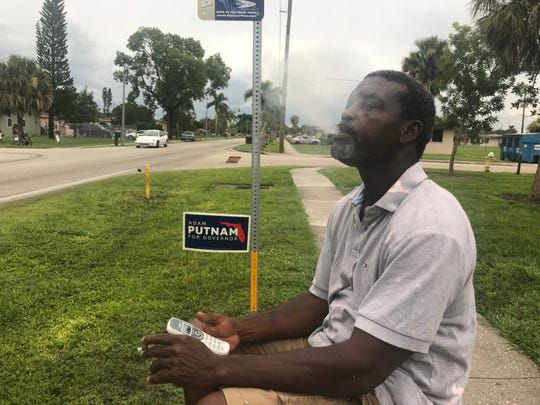 Fort Myers Dana Hines enjoys a cigarette outside the confines of Southward Village where his mother lives. Residents and visitors at the Fort Myers public housing complex can no longer smoke in their homes since a federal smoking ban went into effect for public housing nationwide.