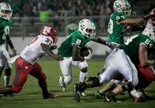 Sias Young of Fort Myers runs the ball against North Fort Myers on Friday, August 31, 2008, at Fort Myers High School.