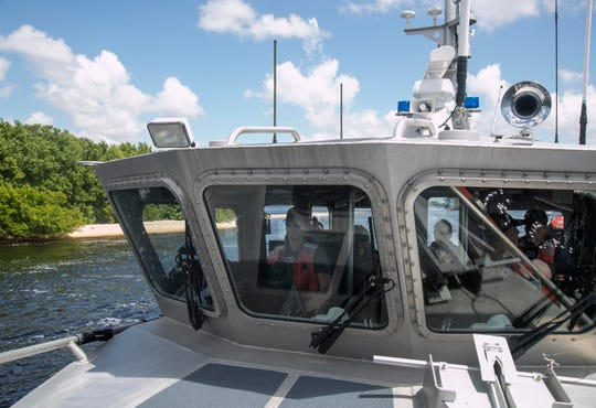 Boastwain's Mate Second Class Dillon Durando acting as Coxswain drives a Coast Guard response boat while the crew patrols looking for unlicensed charter boats on Saturday, September 1, 2018, near the mouth of the Caloosahatchee River.