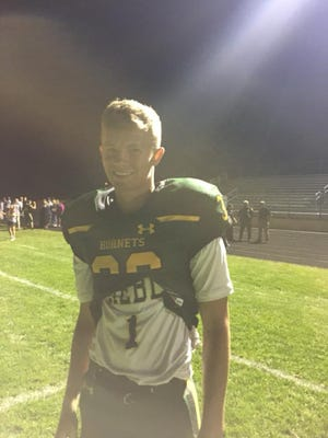 Nick Hummel played both soccer and football for Green Bay Preble on Thursday.  He wore his soccer jersey underneath his football one.