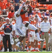 Clemson wide receiver Derion Kendrick (10) catches a pass near Furman cornerback Darius Kearse (2) for a first down during the third quarter in Memorial Stadium in Clemson on September 1.