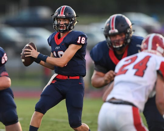 Belton Honea Path quarterback Camden Bratcher (18) plays against Greenville Friday, August 31, 2018, at B-HP's Marlee Gambrell Field in Honea Path.