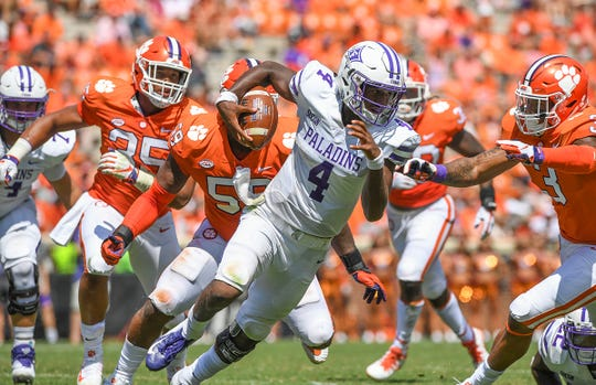 Furman quarterback Darren Grainger (4) carries against Clemson during the 4th quarter Saturday, September 1, 2018 at Clemson's Memorial Stadium.