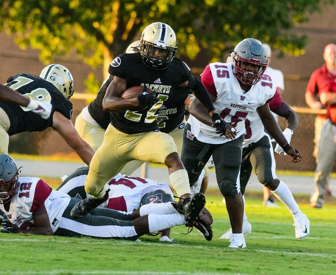 Dre Williams (22) runs 69 yards for a touchdown on Greer's first play from scrimmage in the Yellow Jackets' 48-14 win over Westside Friday night at Dooley Field.