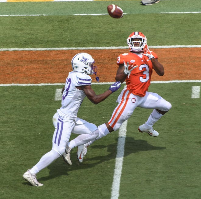 Clemson wide receiver Amari Rodgers (3) catches a pass for a touchdown near Furman cornerback Quandarius Weems (13) during the first quarter in Memorial Stadium in Clemson on September 1.