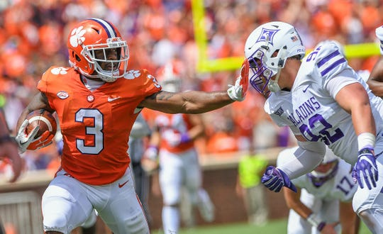 Clemson wide receiver Amari Rodgers (3) stiff arms Furman defensive tackle Matt Sochovka (92) during the 1st quarter Saturday, September 1, 2018 at Clemson's Memorial Stadium.