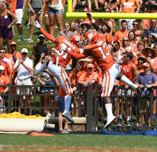 Clemson defensive back Mario Goodrich (31) celebrates with defensive lineman K.J. Henry (13) after recovering a Furman fumble during the 4th quarter Saturday, September 1, 2018 at Clemson's Memorial Stadium.