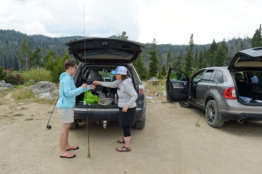 "Jennifer Davis, left, and Shalon Hastings rig up their rods on a recent fishing trip to Park Lake south of Helena, Mont.  When they put the word out on social media, the founding members of Last Chance Fly Gals didn't know what to expect ahead of their first meeting in January. ""We were hoping for 70, but there were 140 women that showed up, and it's only grown from there,"" said Shalon Hastings. ""We've gotten tremendous support.""  (Thom Bridge/Independent Record via AP)"