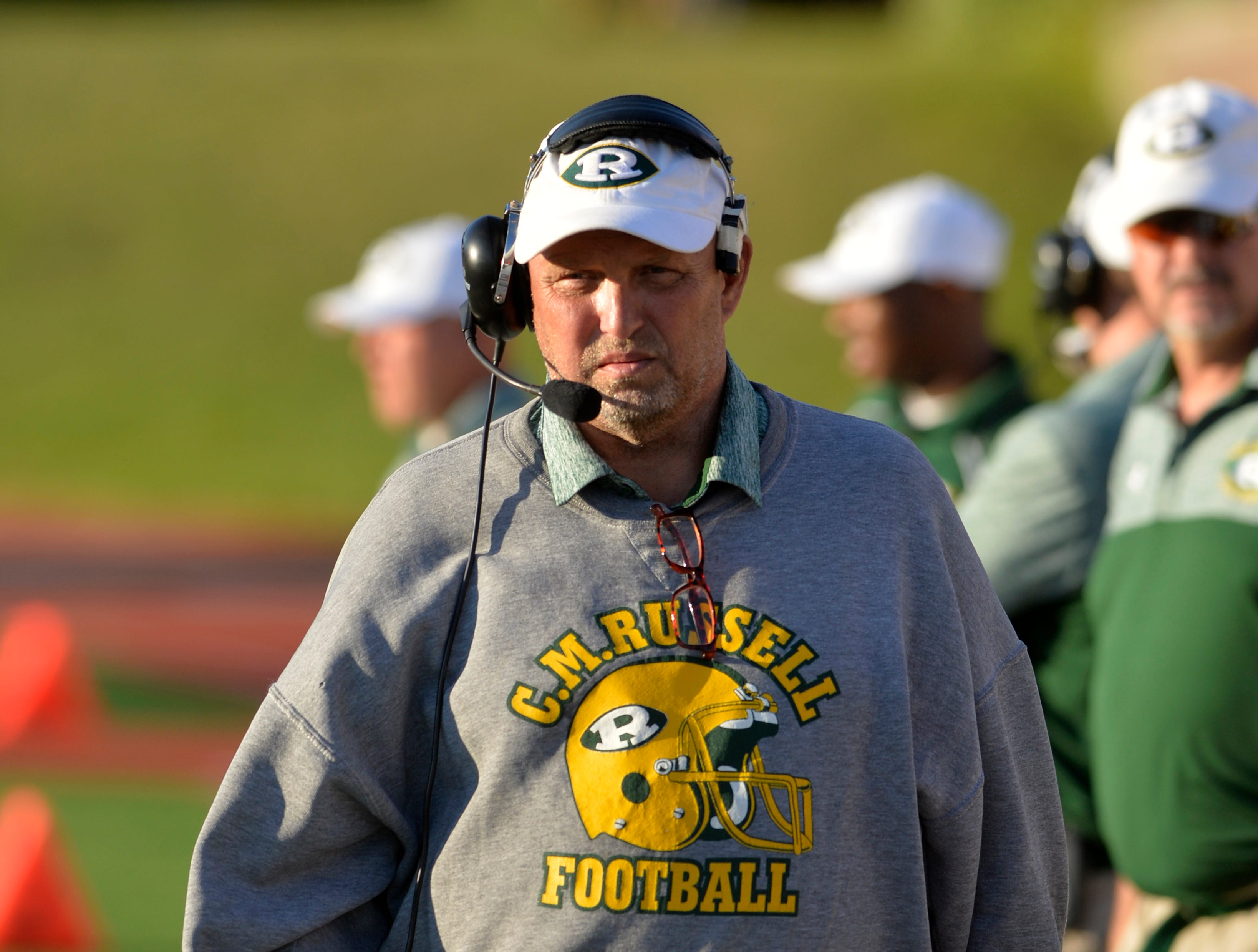 CMR football coach Gary Lowry walks the sideline during Friday's football game against Glacier at Memorial Stadium, August 31, 2018.