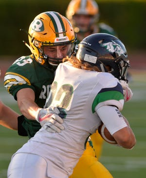 CMR's Bryce Depping attempt to wrap up Glacier's Preston Blain during Friday's football game at Memorial Stadium last weekend.