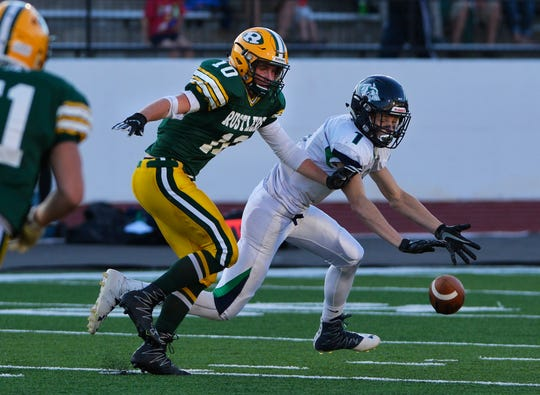 CMR's Tucker Greenwell defends a pass intended for Glacier's Colin Bowdin during last Friday at Memorial Stadium.