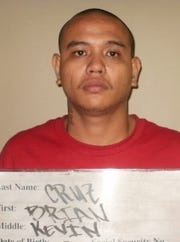 In this May 2013 file photo shows the mugshot of Brian Kevin Cruz, who had been arrested in connection with a purse snatching. He possibly abducted his girlfriend Friday, in an incident being investigated by police.