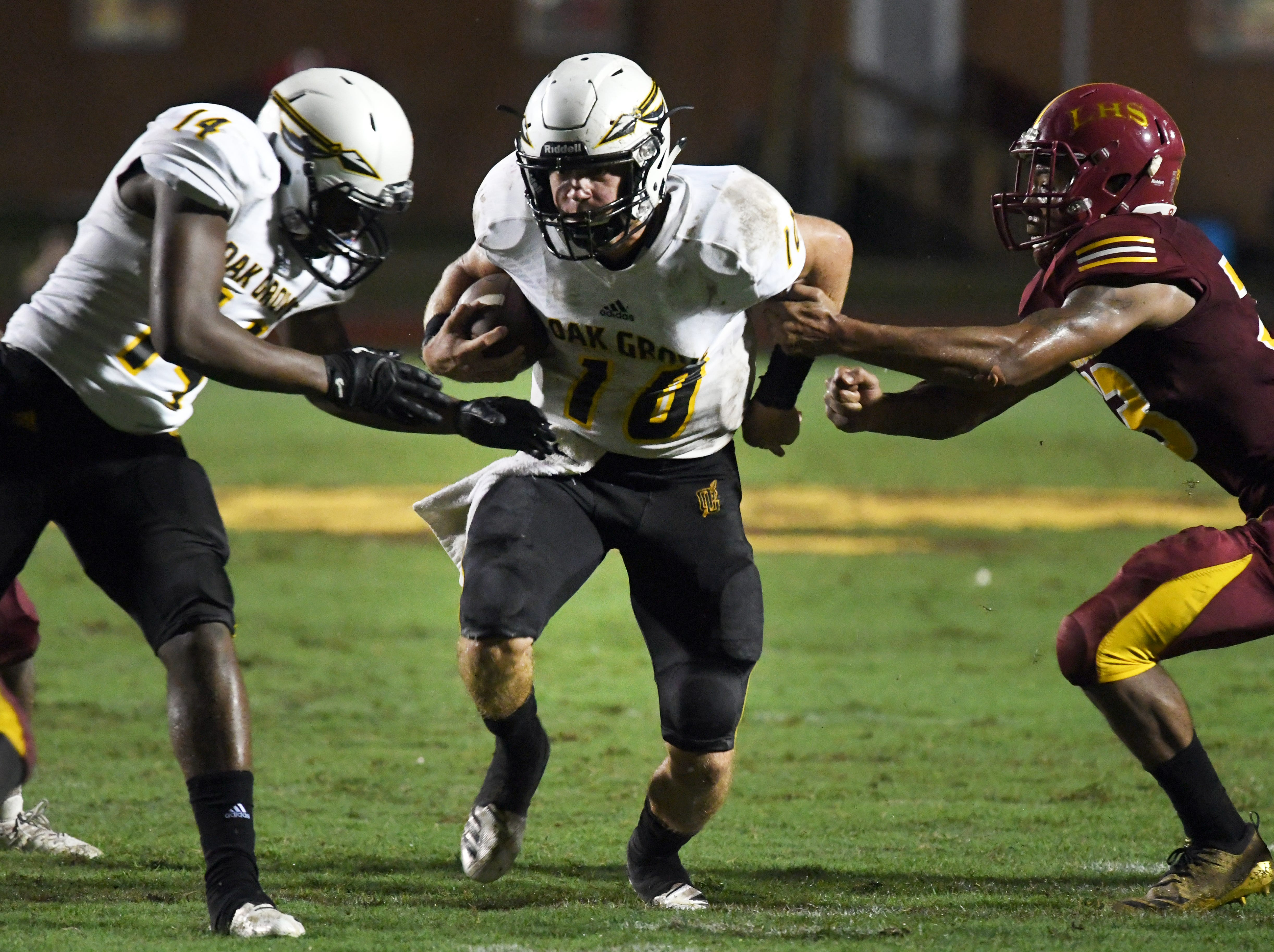 Oak Grove quarterback John Rhys Plumlee carries the ball in a game at Laurel on Friday, August 31, 2018.