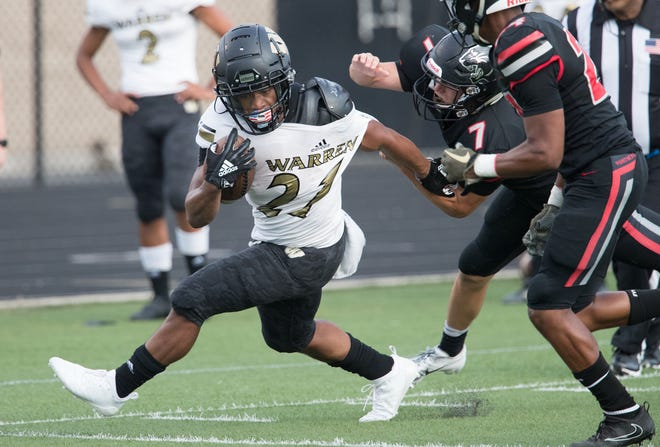 Romeir Elliott carries for Warren Central High School during a 58-27 romp for Warren Central High School as they defeat North Central High School at home, Indianapolis, Friday, Aug. 31, 2018.