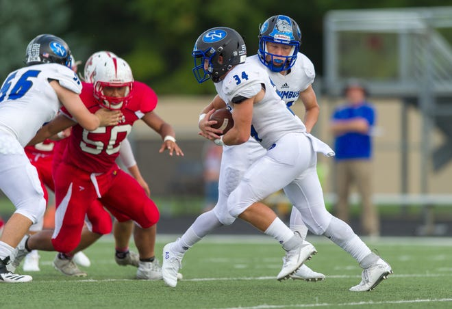 Columbus North High School sophomore Blake Huffman (34) rushes the ball out of the backfield during the first half of action. Southport High School hosted Columbus North High School in IHSAA varsity football action, Friday, Aug. 31, 2018.