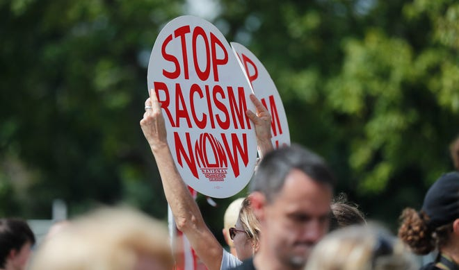 Hundreds of anti-hate protesters gather outside the poorly attended Ku Klux Kookout at Jaycee Park in Madison Ind. on Sat. Sept. 1, 2018. The event, attended by around 15 people, was put on by a chapter of the KKK, calling themselves the Honorable Sacred Knights of the Ku Klux Klan.