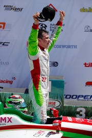 FILE – Pato O'Ward celebrates after winning the Indy Lights race July 8, 2018, at Iowa Speedway. His win in Portland on Saturday gave the Mexican driver the Indy Lights title.