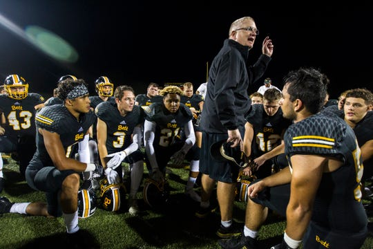 Bettendorf football head coach Aaron Wiley talks with players after a 4A varsity football game on Friday, Aug. 31, 2018, at TouVelle Stadium in Bettendorf.