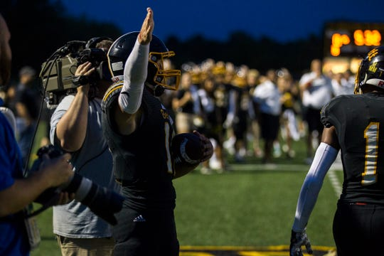 Bettendorf quarterback Carter Bell gestures for a first down during a 4A varsity football game on Friday, Aug. 31, 2018, at TouVelle Stadium in Bettendorf.