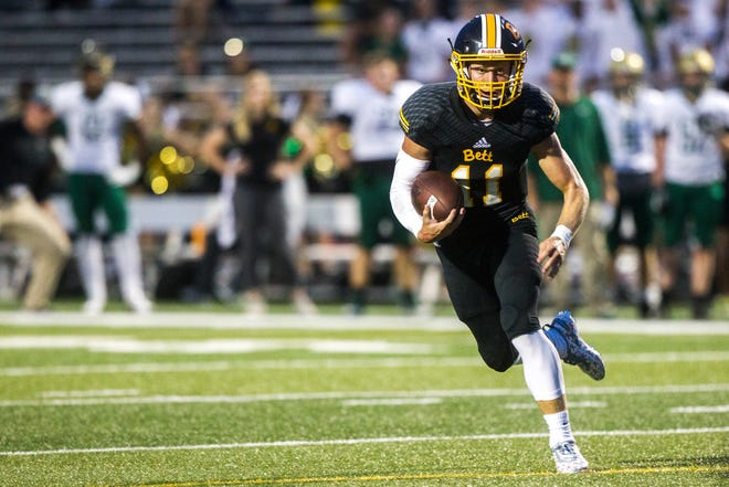 Bettendorf quarterback Carter Bell (11) rushes during a 4A varsity football game on Friday, Aug. 31, 2018, at TouVelle Stadium in Bettendorf.