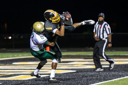 Bettendorf wide receiver Darien Porter (10) catches a pass for a touchdown during a 4A varsity football game on Friday, Aug. 31, 2018, at TouVelle Stadium in Bettendorf.