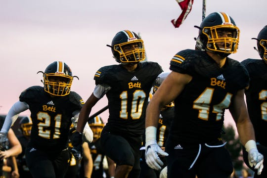 Bettendorf wide receiver Darien Porter (10) runs onto the field with teammates during a 4A varsity football game on Friday, Aug. 31, 2018, at TouVelle Stadium in Bettendorf.