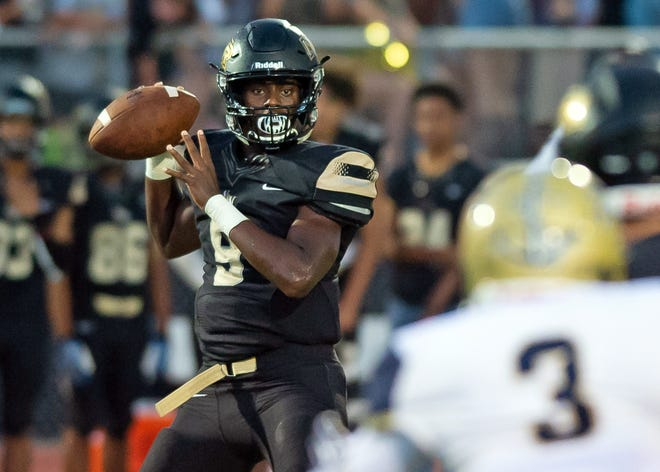 Northwest Rankin quarterback Jamari Jones looks to throw against Pearl during game action in Flowood MS, Friday August 31, 2018.(Bob Smith-For The Clarion Ledger)