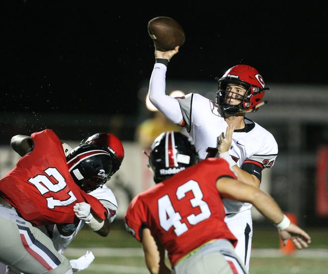 Clinton High School's Hunter Hulsey (17) releases a pass. Brandon and Clinton played in a Class 6A football game on Friday, August 31, 2018 at Brandon High School. Photo by Keith Warren