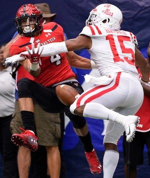Mississippi defensive back Myles Hartsfield (15) breaks up a pass intended for Texas Tech wide receiver Antoine Wesley (4) during the first half of a college football game, Saturday, Sept. 1, 2018, in Houston. (AP Photo/Eric Christian Smith)