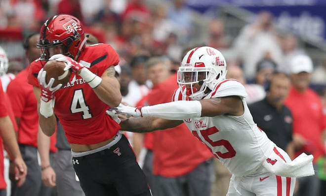 Sep 1, 2018; Houston, TX, USA; Texas Tech Red Raiders wide receiver Antoine Wesley (4) makes a catch against Mississippi Rebels defensive back Myles Hartsfield (15) in the second quarter at NRG Stadium. Mandatory Credit: Thomas B. Shea-USA TODAY Sports