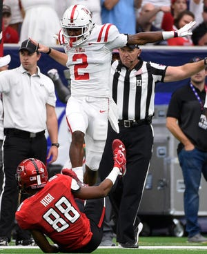 Mississippi defensive back Montrell Custis (2) reacts after breaking up a pass intended for Texas Tech wide receiver Ja'Deion High (88) during the first half of a college football game, Saturday, Sept. 1, 2018, in Houston. (AP Photo/Eric Christian Smith)