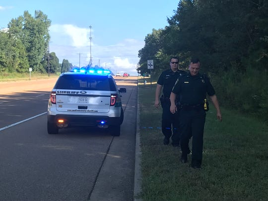MCSO Sergeant Richard King and a deputy walk back to King's vehicle after a traffic stop.