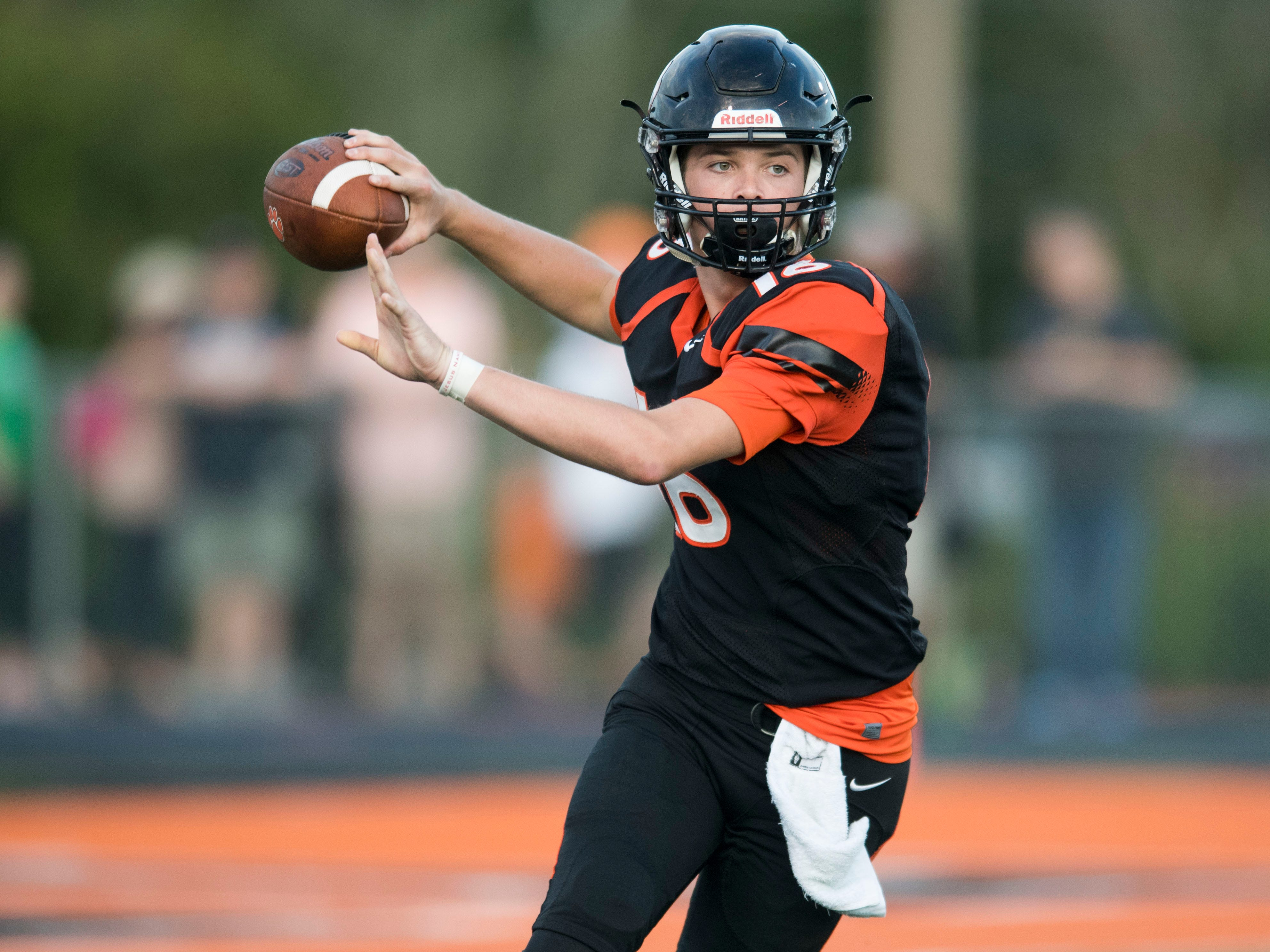 Powell's Walker Trusley (16) sets to throw during the football game against Fulton on Friday, Aug. 31, 2018.