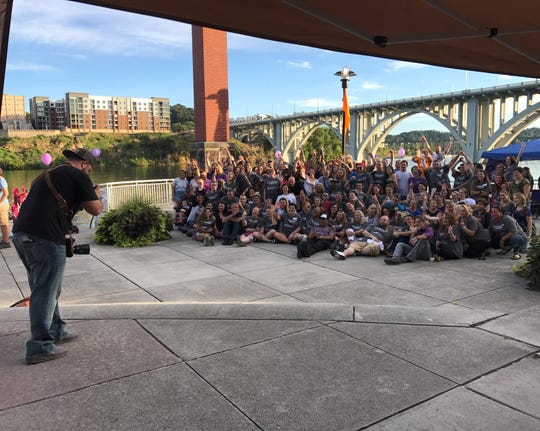 Zach Hawkins of Zach Hawkins Photography gets a photo of 120 people in recovery who will be featured on a billboard.