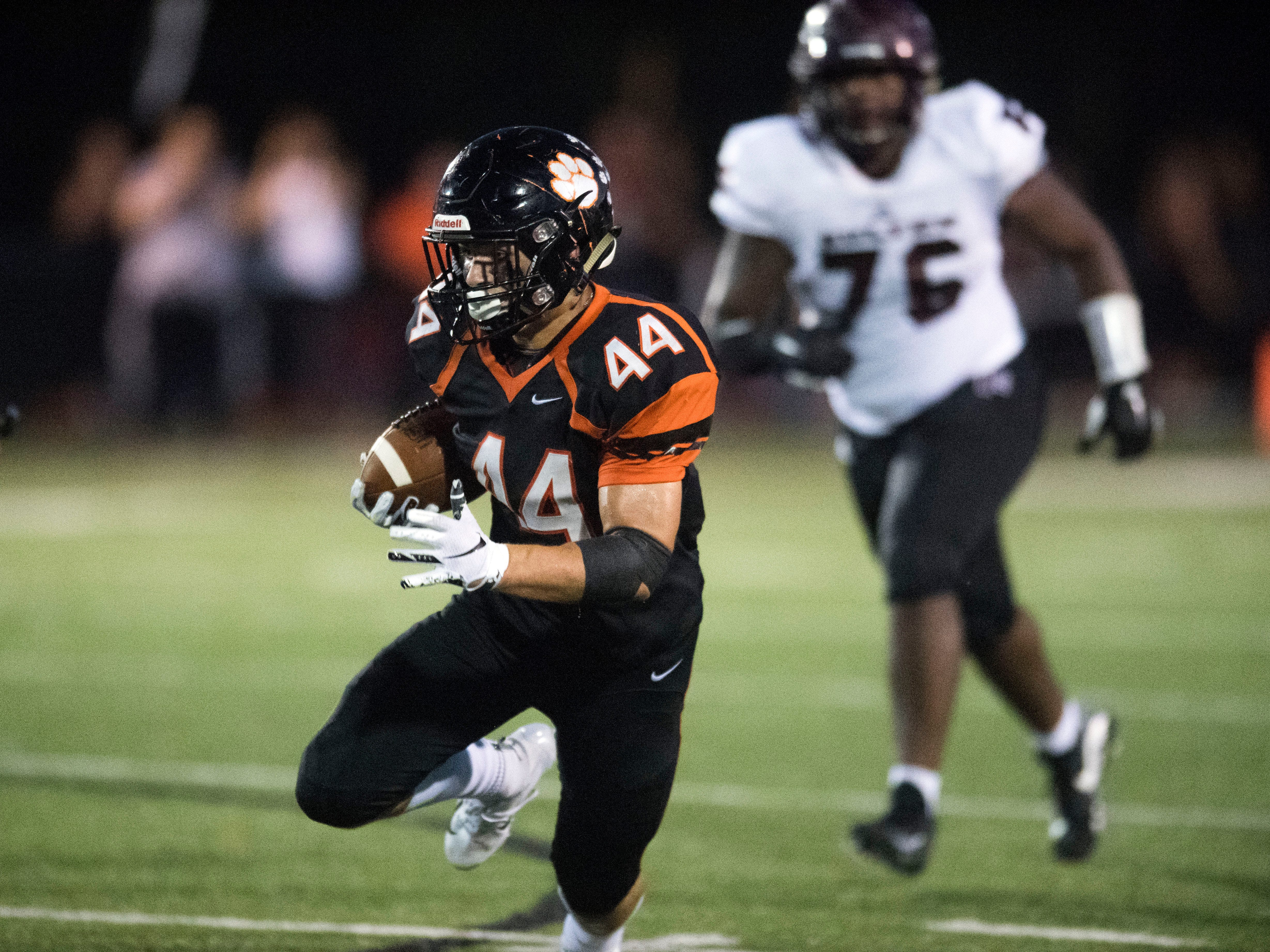 Powell's Eli Owens (44) runs for yards in the football game against Fulton on Friday, August 31, 2018.