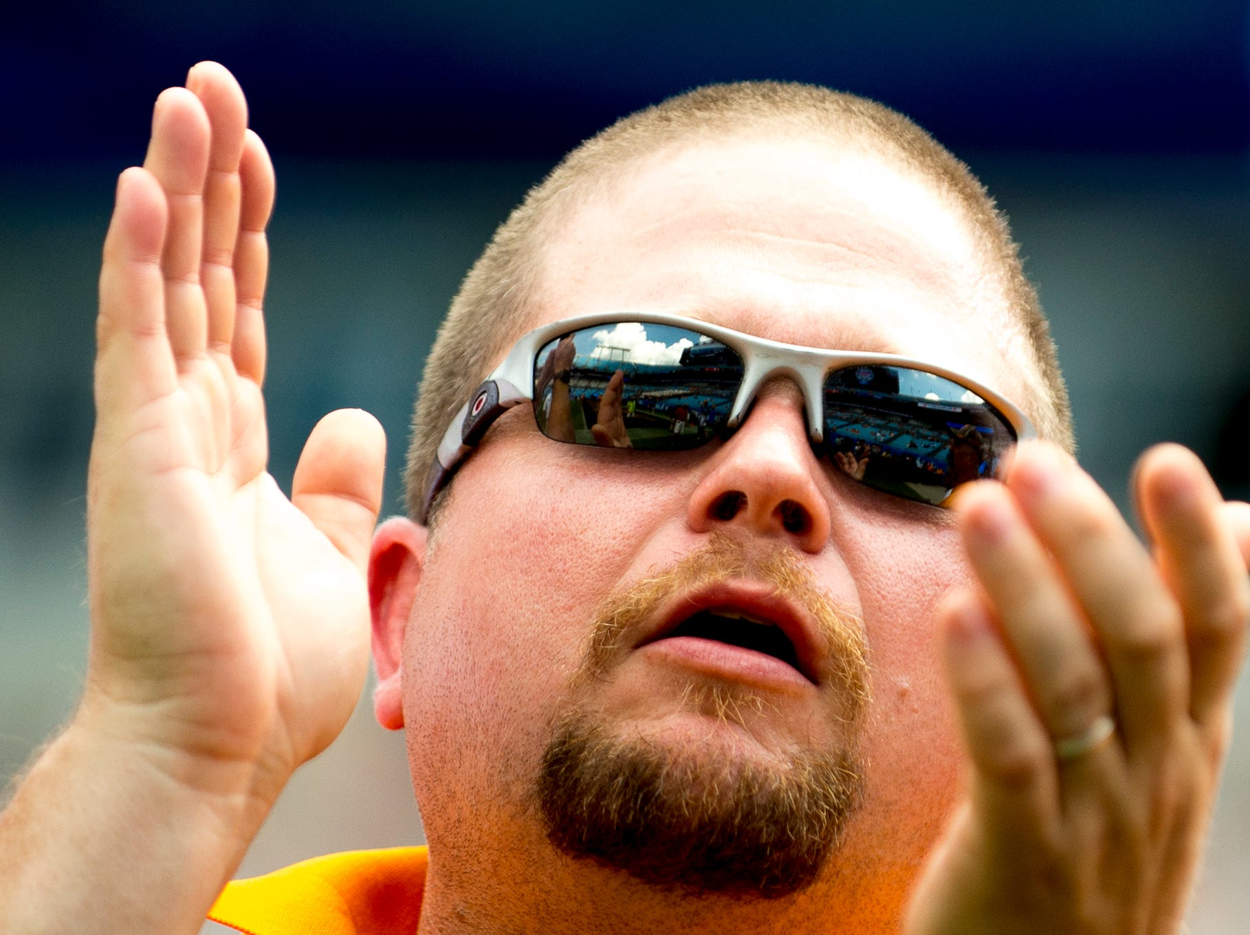 `A Tennessee fan cheers from the stands during the Belk College Kickoff between Tennessee and West Virginia at Bank of America Stadium in Charlotte, North Carolina on Saturday, September 1, 2018.