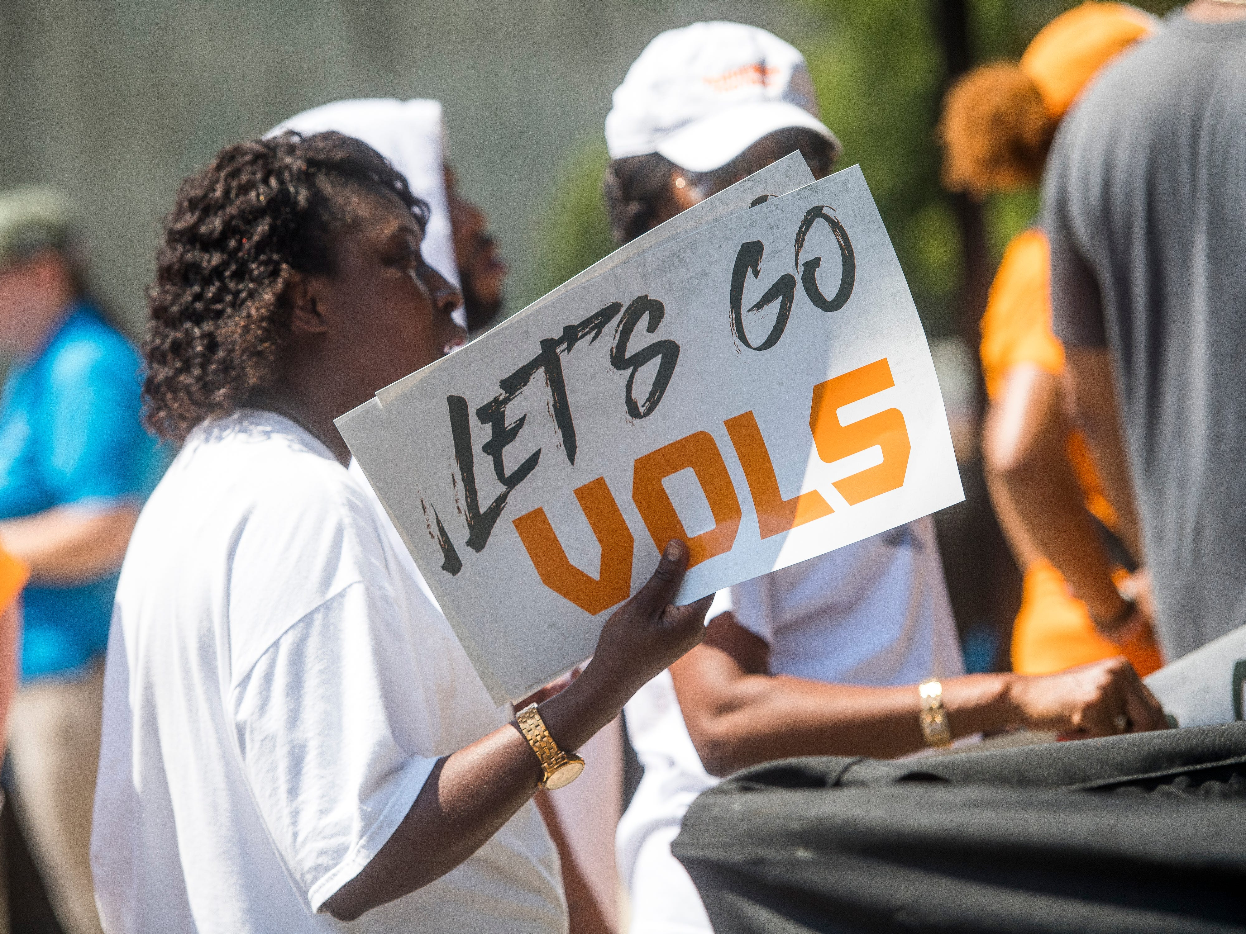 Fans use signs to fan themselves before the Tennessee Volunteers' game against West Virginia in the Belk College Kickoff at Bank of America Stadium in Charlotte, N.C., on Saturday, Sept. 1, 2018.