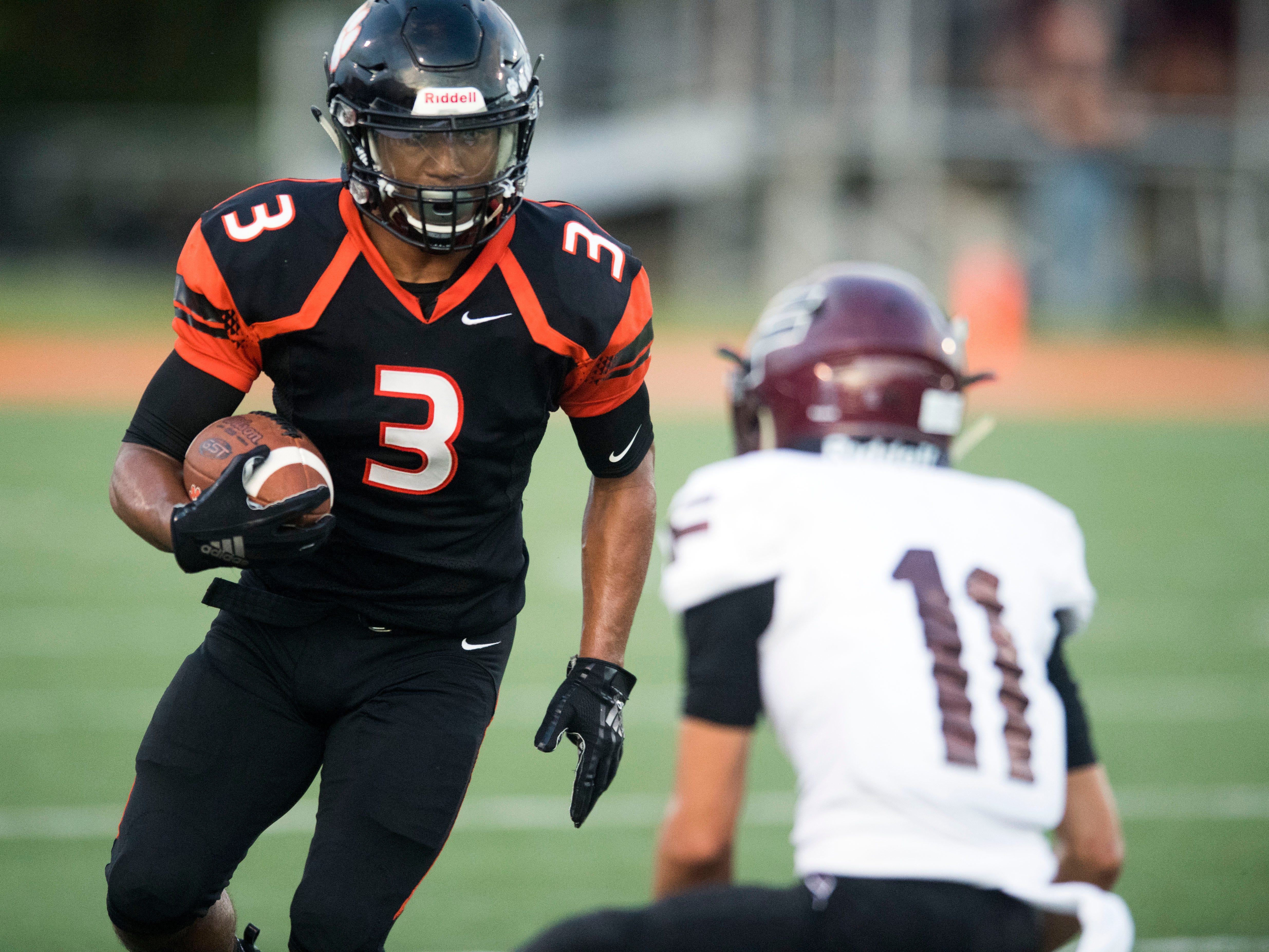 Powell's Bailor Walker (3) comes up against Fulton's Kenny Buley (11) during the football game at Powell on Friday, August 31, 2018.