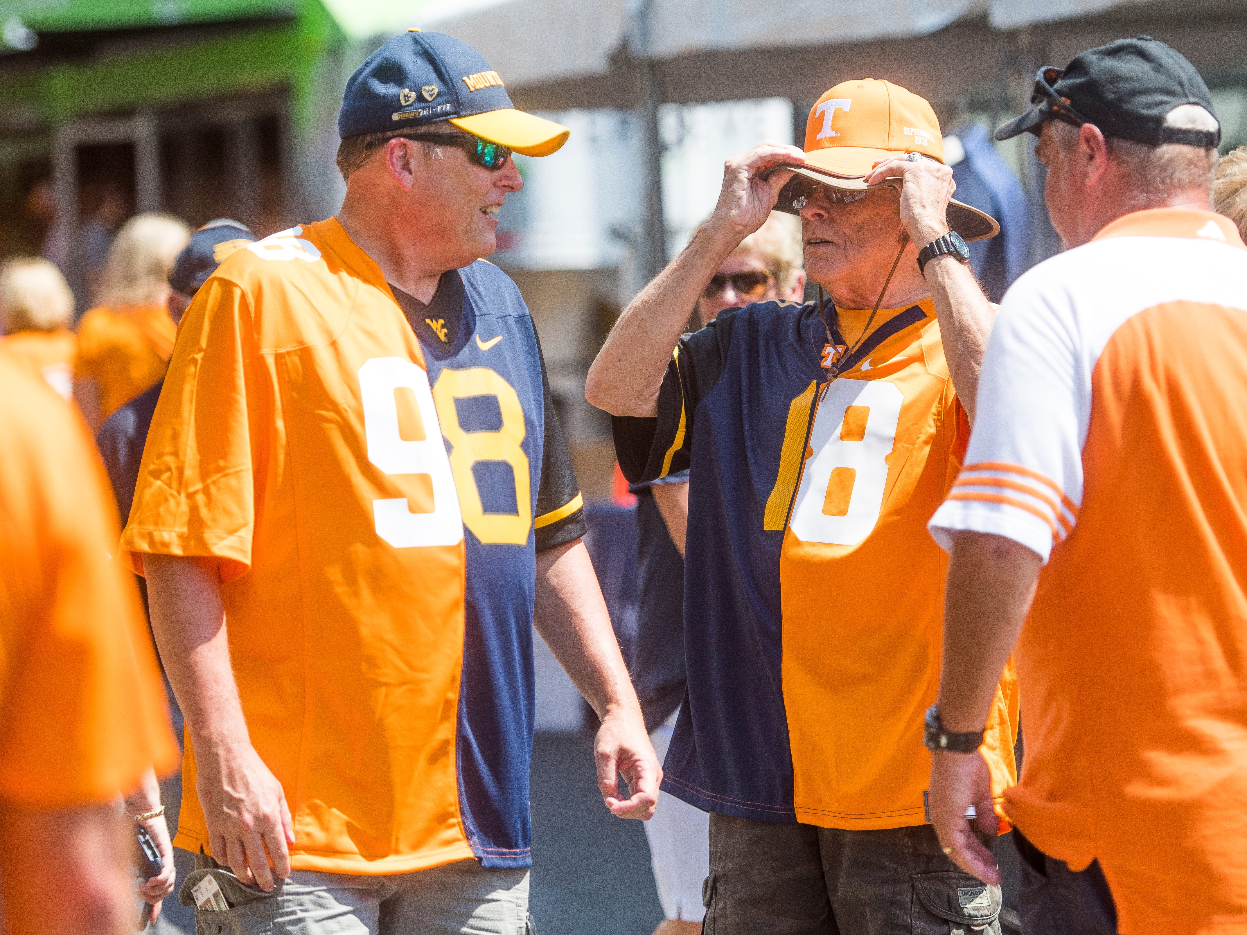 Lee Kelly, left, and Robert Kelly, right, sport jerseys supporting both the Vols and WVU before the Tennessee Volunteers' game against West Virginia in the Belk College Kickoff at Bank of America Stadium in Charlotte, N.C., on Saturday, Sept. 1, 2018.
